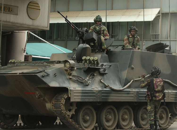 Soldiers are seen on the armoured vehicle outside the parliament in Harare, Zimbabwe. Picture: REUTERS/PHILIMON BULAWAYO