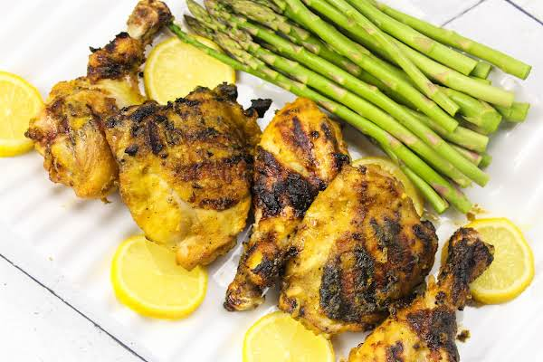 Platter Of Grilled Chicken Thighs And Drumsticks.