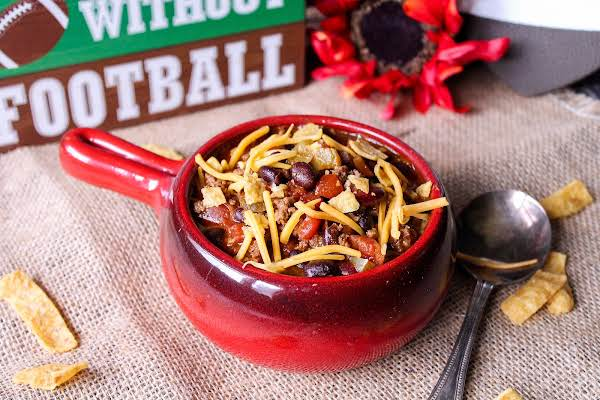 Football Chili Topped With Corn Chips And Cheese.
