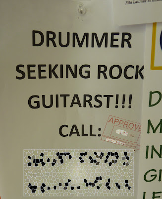 Poster Text: Drummer Seeks Rock Guitarst