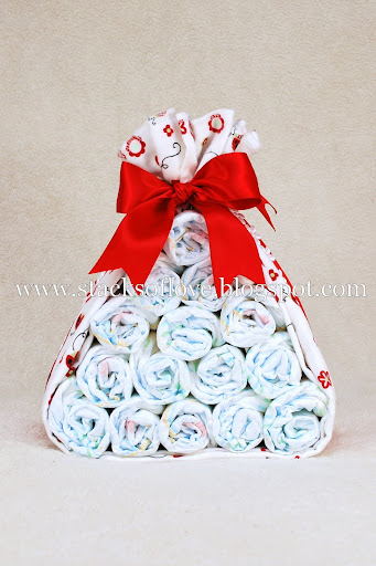 Diaper Cake Stork Bundle with Ladybug theme wrapped in blanke