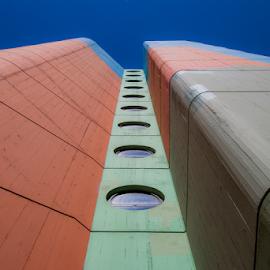 Flying V by Alexandre Mestre - Buildings & Architecture Architectural Detail ( sky, blue sky, art, lisbon, portugal, artistic, bl, windows, building, colors, grey, orange, blue, lisboa, looking up, window, architecture )