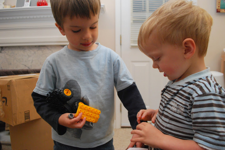 Ian helps Isaac with his new Duplo truck