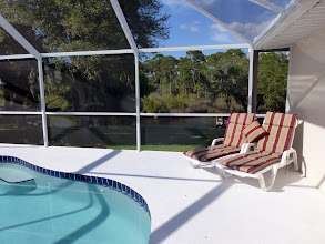 Photo: Repainted pool and lanai deck with two new sun loungers and new throw cushion