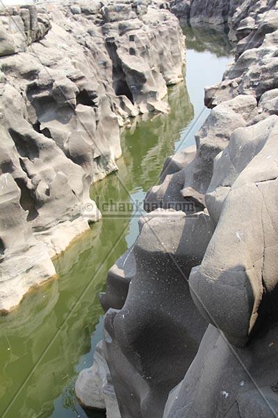 Kukdi river making way through potholes