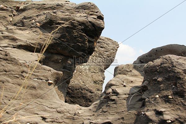Rocks carved by potholes