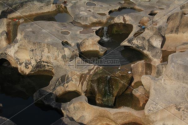 Tiny waterfalls in potholes