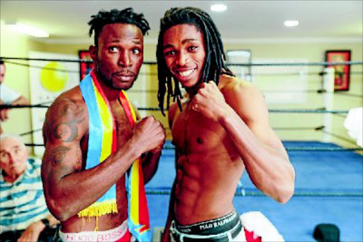 Congolese Eric Kapia Mukadi, left, and SA's Thulani  Mbenge square off ahead of their fight for the vacant ABU welterweight belt,  at Emperors Palace, on Thursday night. PHOTO: Nick Lourens