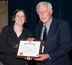 Photo: Director of Alumni Affairs Tricia Gomulinski presents Marvin E. Criswellwith 2014 Outstanding Advisor plaque.