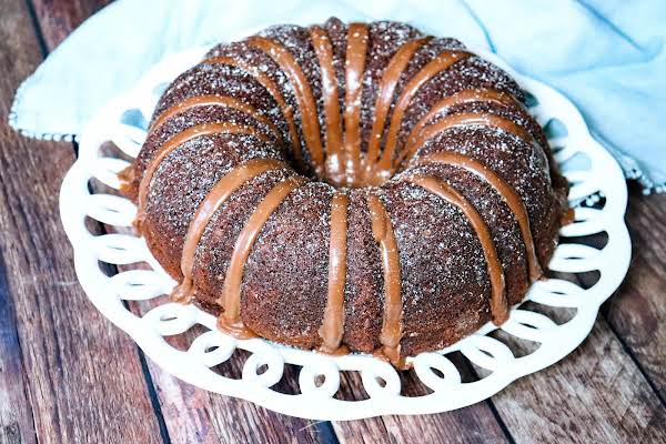 Inside-out German Chocolate Bundt Cake With A Chocolate Powdered Sugar Drizzle.