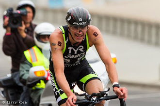 Photo: Andy Potts (USA) climbs on bike at the 2014 Escape from Alcatraz Triathlon on June 1, 2014 in San Francisco, CA