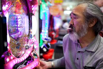 Photo: June 6, 2015. Minami Soma. Unable to tend his gardens, Kobayashi's new hobby is spending most of the day playing one yen pachinko before a night of drinking.
