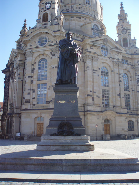 Dr. Martin Luther still points to the Scriptures in front of the Frauenkirche in Dresden