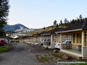 Photo: Row of cabins with Terraces in background