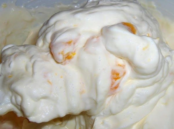Fold the thawed cool whip into the orange mixture; gently fold in chopped oranges,...