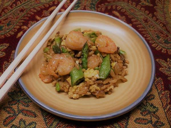 Plated Shrimp And Veggie Fried Rice With Chopsticks.