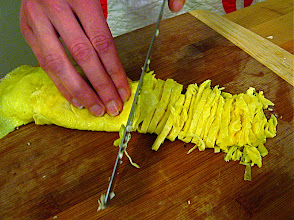 Photo: cutting egg crepes into thin shreds