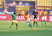 Jonathan Kodjia of Cote d'Ivoire against Buhle Mkhwanazi of South Africa during the African Cup of Nations match between Cote d'Ivoire and South Africa at Al-Salam Stadium on June 24, 2019 in Cairo, Egypt.