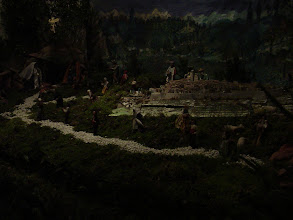 Photo: A manger scene holds a model of the walled town.