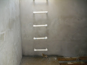 Photo: The concrete cistern is divided into two chambers.  PVC stairs lead the bottom to make cleaning easier.