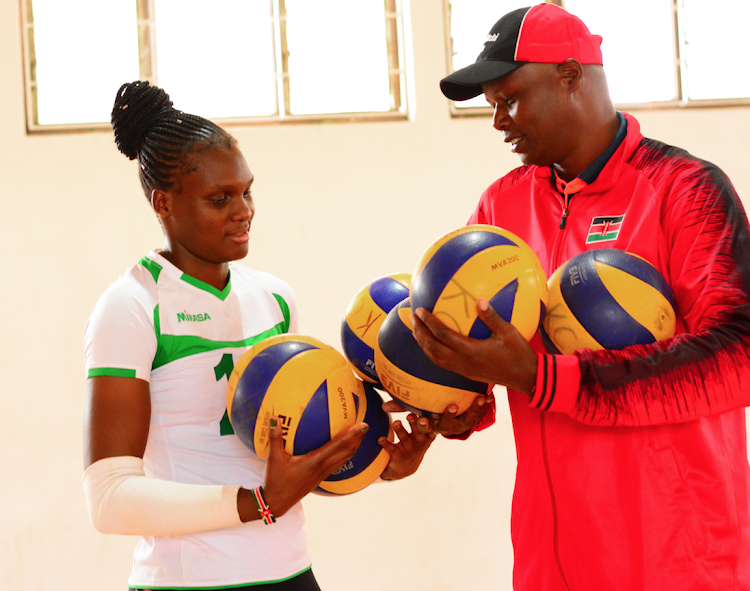 Malkia Strikers head coach Paul Bitok with Edith Wisa during a a past training session