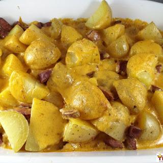 Cajun Cheesy Smoked Sausage and Potato Bake.