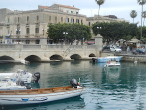 Photo: When we were done seeing the archaeological we moved the car and walked onto the island of Ortygia, which is the historical center of Siracusa.   This picture shows the bridge from the mainland onto Ortygia.