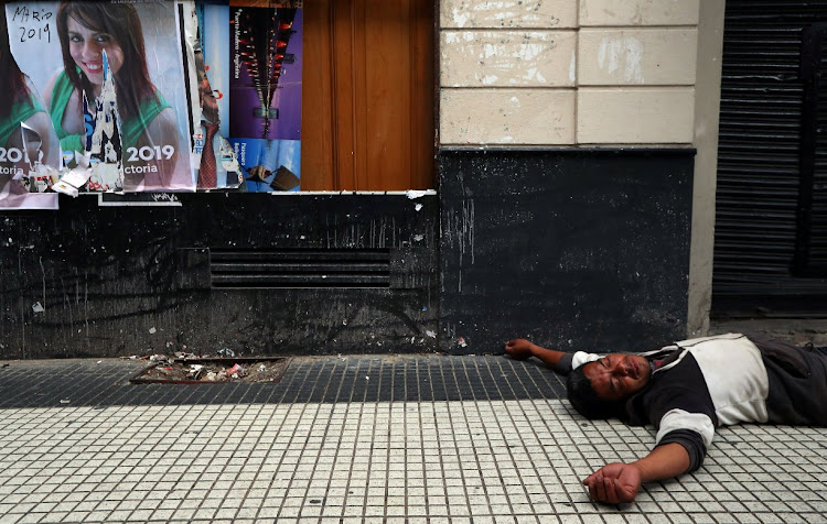 A man passed out during a protest against a cost increase in utility services in Buenos Aires, Argentina.
