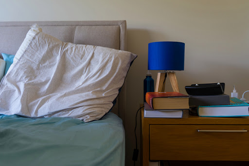It's time that I apologize for insulting my husband's cluttered nightstand