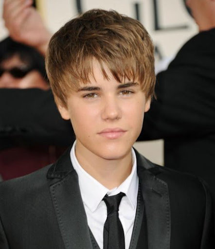 justin bieber in purple suit. justin bieber haircut at