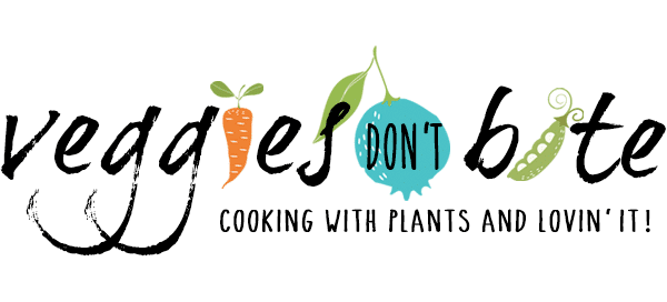 logo for veggies don't bite with black letters and colored veggies
