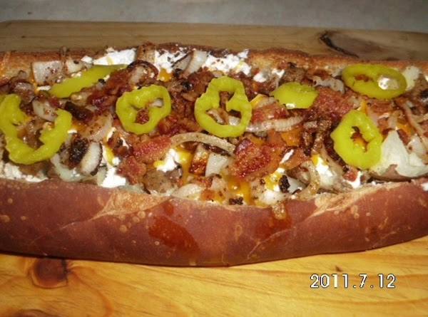 Place into bread:  baked potato, feta cheese, cheddar cheese, bacon, onions and pop...