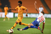 Nkosingiphile Ngcobo of Kaizer Chiefs in action with Deolin Mekoa of Maritzburg United during the Absa Premiership match between Kaizer Chiefs and Maritzburg United at FNB Stadium on March 09, 2019 in Johannesburg, South Africa.