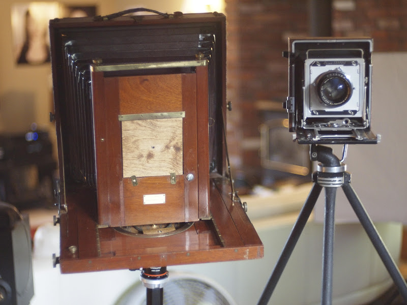 Photo: A good example of the size difference between a 4x5 camera (Graflex Crown Graphic. 1940 something) and a 10x12 camera (Carlton. 1895.)