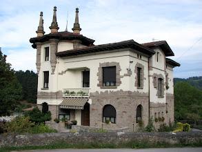 Photo: A Basque style house next to the sheep farm.