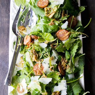 Baby Kale Salad with Chorizo, Manchego and Crispy Leeks