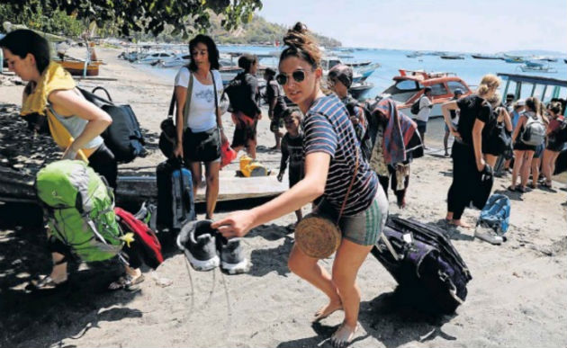 Foreign tourists leave Gili Trawangan island after an earthquake hit Lombok island in Pemenang, Indonesia