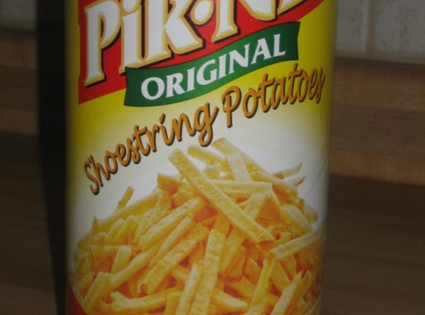 Add shoestring potatoes just before serving, and mix well.  If you mix it...