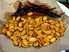 Photo: fried peanuts and dried Thai chillies