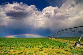 """Photo: """"Rainbows, Farmland and Thunderstorms"""" Photo Thoughts-- Wasn't really expecting a rainbow while storm chasing last week out on the Colorado eastern plains but heck I sure will take it and won't complain! lol I intentionally wanted the irrigation sprinkler in the shot for a sense of scale but also go beyond a simple landscape and into a travelscape style photograph..so I went ahead and tried to work it into the overall composition and wanted a leading line that went sort of right where the rainbow ended. Hope you all like it! John  #stormyfriday curated by +Reinhard Latzke  #colorsonfriday curated by +Gilmar Smith +E.E. Giorgi  #rural #country #landscape #travel #travelphotography #colorado  #nature #naturephotography #sky #clouds #cloudpoker #storm #cowx #rainbow #weather #weatherphotos #exposedphoto #plusphotoextract #photoplusextract"""