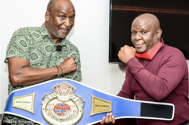 Businessman Kenny Mametsa (left) and retired boxer Ditau Molefyane pose with the WBF belt that was presented to Molefyane.