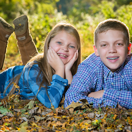 Smiling in the leaves by Dave Dabour - People Family ( lauren, 2016, fall, leaves, clinton, rick, girl, boy, brother, sister, mill,  )
