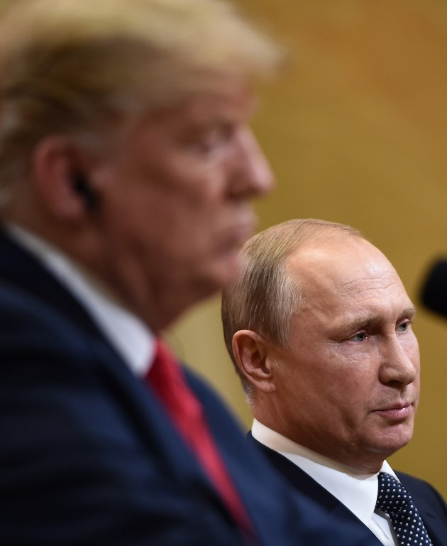 US President Donald Trump and Russia's President Vladimir Putin attend a joint press conference after a meeting at the Presidential Palace in Helsinki on July 16 2018