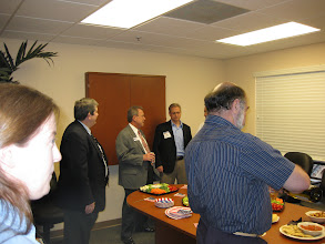Photo: Mercantile Capital Corporation's guests networking in the conference room www.504Experts.com