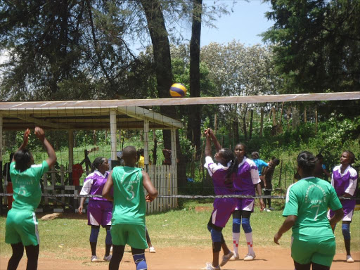 GAMES BY SONU TANU,KERICHO APRIL 9 CAPTION PIX-DSC07423- Tambach Volley ball women team squares out with Kamagambo at the Kericho Teachers' College playing ground. By Sonu Tanu.