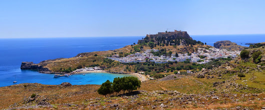 Photo: Lindos city with the acropolis on top of the hill.