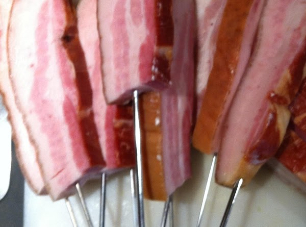 Skewer your bacon pops with metal or wooden skewers. If using wood, pre-soak for...
