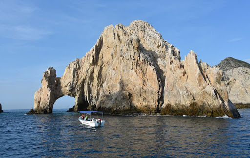 los-archos-boat.jpg - A tour boat approaches El Arco, the most famous rock formation in Cabo San Lucas.