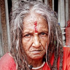 Ochre Medusa  by Mrigankamouli Bhattacharjee - People Portraits of Women ( saffron, female, lady, saint, sadhu, yogini )