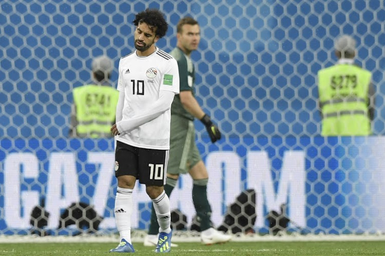 Egypt's forward Mohamed Salah reacts after missing a chance during the Russia 2018 World Cup Group A football match between Russia and Egypt at the Saint Petersburg Stadium in Saint Petersburg on June 19, 2018.